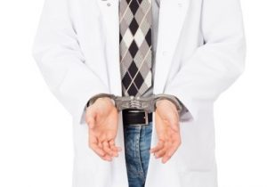 doctor handcuffed